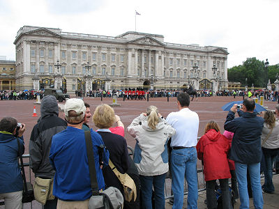 Thousands of onlooker watch the changing of the guard at Buckingham Palace