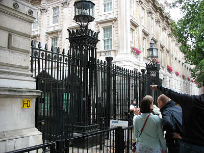 Gate and guards keep curiosity seekers, political opponents and terrorists out of Downing Street, location of the Prime Minister's residence