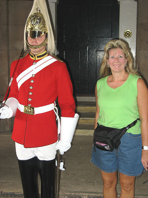 Susan standing next to one of the guards at the Horse Guards