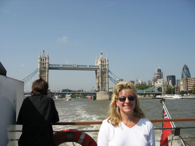 Susan on the back of the ship, with Tower Bridge in the background