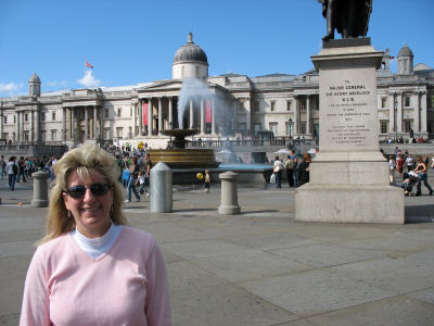 Fountains and statues in Trafalgar Square. The National Gallery is in the background.